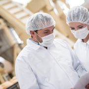 Inspectors at a food factory